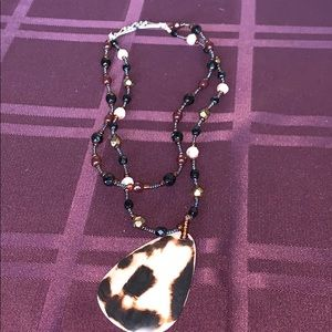 Brown necklace with shell like pendant